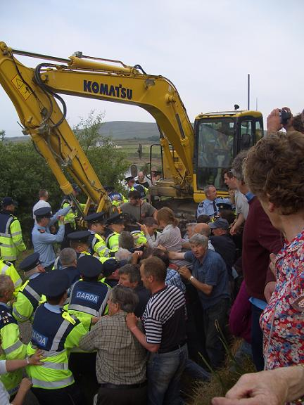 Guards force digger through crowd